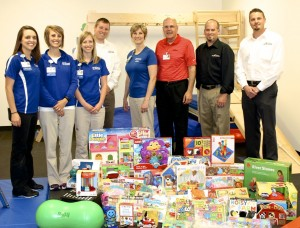 Jake and Roger Buhnerkempe of J&R Collision Centers recently contributed $1,000 of toys, educational materials and physical development items for HSHS St. Anthony's Memorial Hospital's Physical Rehabilitation and Wellness department located at the Workman Sports and Wellness Complex.  Shown with the donated items are (left to right) St. Anthony's pediatric therapists Sarah Buhnerkempe, Occupational Therapist, Keli Dhom, Physical Therapist, and Teresa Beck, Speech Therapist; Jake Buhnerkempe, Co-owner, J&R Collison Centers; Candy Jansen, St. Anthony's Director of Rehabilitation and Wellness; Michael Wall, St. Anthony's Director of Philanthropy; Scott Sapp, General Manager, J&R Collison Centers, Effingham; and Daniel Norton, General Manager, J&R Collison Center, Shelbyville.