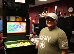 George Tucker, Mattoon, poses with his Augmented Reality Sandbox, which he designed and created in the Innovation Lab and Maker Space at Lake Land College.